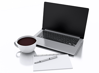 Laptop coffee and notepad